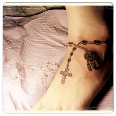 Ankle charm bracelet dream catcher and cross adding more to it as time goes