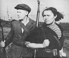 Siege of Leningrad: Two members of the People's Militia are photographed on the banks of the Neva river sometime in the fall of 1941. The entire able-bodied population of the city was mobilized for the defense. The People's Militia was the largest force of citizen soldiers under the command of Red Army officers.