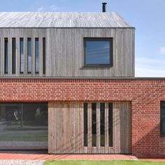Nash Baker Architects combines brick base and gabled timber top for Broad Street House