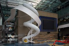 The tubular white slide inside Corus Entertainment's impressive new Toronto headquarters spans three stories and offers employees and visitors a chance to take a break from whatever grown-up responsibilities they are dealing with and simply enjoy being young at heart for a few moments. Besides offering a fun distraction from the day that lines up well with the company's area of business, Corus' slide adds a unique architectural element to their very modern new building.
