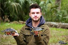 Park Ranger, Clint, shows off a couple of Yellow Belly Slider Turtles during the reptile show.