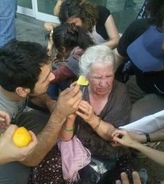 People stopped to help strangers suffering the effects of tear gas.  #occupygezi #direngeziparki #occupyturkey #direnizmir #direnankara