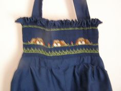 """The Khaki Puppies"" Creative Keepsakes smocking plate set into a navy sunsuit"