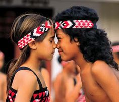 Cute - Hongi Greeting - ceremonial touching of noses - Maori Tribe - New Zealand -