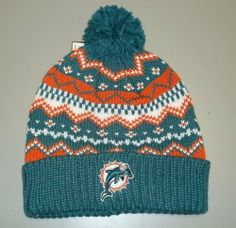 Miami Dolphins Cuffed with POM Knit Reebok Hat by Reebok. $8.99. POM. CUFFED. THIS IS A 100% ACRYLIC TEAL, ORANGE AND WHITE CUFFED AND POM REEBOK KNIT HAT. THE TEAM LOGO IS EMBROIDERED AND RAISED ON THE FRONT. Save 50%!