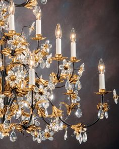 Found the original chandelier in the new house: wrought-iron chandelier with Italian glass flowers