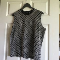 Sleeveless Top Very nice top for spring, summer and fall. It's sized XL (16-18). It's too small for me now. It's been worn a couple of times. True to size. Pet free, smoke free home. I never dry my clothes in dryer. George Tops Blouses