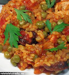 Chorizo sausages, chicken & peas spicy rice