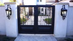 Accompanied by light fixtures, an all-custom, wrought iron, double entry gate was added to this Spanish style home. Front Gates, Entry Gates, Front Fence, Iron Fence Gate, Wrought Iron Fences, House Entrance, Gate House, Colonial Style Homes, Spanish Style Homes