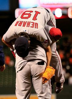 BALTIMORE, MD - APRIL 02: David Ortiz #34 of the Boston Red Sox picks up closer Koji Uehara following the Red Sox 6-2 win over the Baltimore Orioles at Camden Yards on April 2, 2014. (MORE GAME PINS ON MY NEW BOARD: Red Sox 2014)