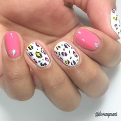 Here I used Kyoto's Cherry Blossom by Bonita Colors, Alpine Snow by OPI, and acrylic paint. The studs I purchased from Amazon