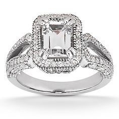 This emerald-cut engagement ring features a plethora of sparkling round-cut diamonds on the white gold ring band. The center emerald cut diamond is Bling Bling, Emerald Cut Engagement, Halo Engagement Rings, Emerald Cut Diamonds, Diamond Cuts, Big Diamonds, Emerald Rings, Diamond Stone, Ruby Rings
