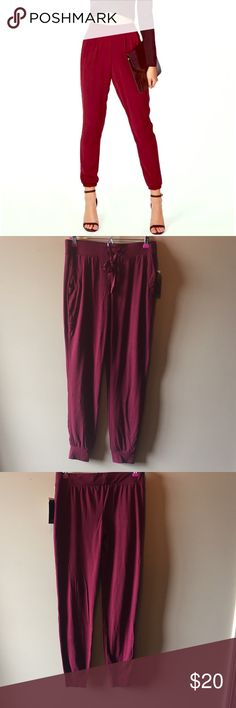 Wine Red Joggers Brand new. Never worn. 92% polyester. 8% spandex.                                                               PSA                                                                     No trades                                                                   Reasonable Offers are Accepted                             Depending on when you order, I will ship the same day or the next business day Almost Famous Pants Track Pants & Joggers