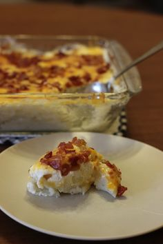 Mashed potatoes topped with 8oz. sour cream, cheddar, and bacon bits.  Bake at 350 for 15 min.