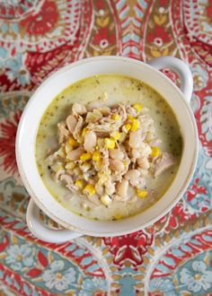 Corn and Chicken White Chili Recipe - made in the slow cooker - dried northern beans, chicken, green chiles, corn, chicken broth, half-and-half, cumin - slow cooks all day. Serve with some crusty bread or cornbread for an easy weeknight meal!