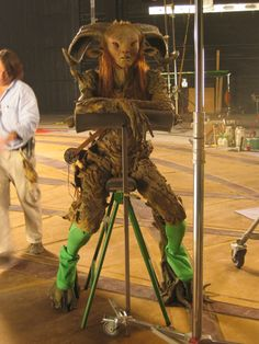 Doug in between shots, resting on a chair designed especially for him by DDT, as he found it difficult to sit comfortably in the prosthetics. He could also rest his head on the padded bar as the horns were extremely heavy.