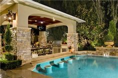 I love the pool bar. Connect it to a covered patio with an awesome giant fireplace, plasma TV, and grill then my backyard would be complete. I don't need grass just flower beds. I am so tired of a big yard!