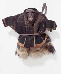Wood; wool cloth; reindeer skin; brass bells  Measurements Width 38 cm Length 35 cm   Creator name Unknown  Creator date Unknown  Where it was made Russia; Siberia, town of Salekhard (former Obdorsk)  Geography Russia; Siberia  Time period AD 19th century ~ AD 20th century  Creation date Before 1911