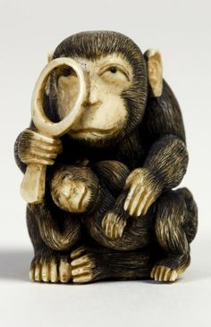 Japanese Netsuke in the Form of a Monkey with a Magnifying Glass.  Artist: O-sei.  19th century-20th century.  Ivory