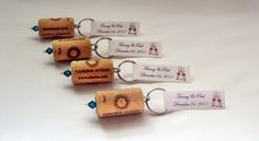 "I now know what to do with all my wine corks.100- Wine Cork Keychain Favors- Great Wedding or Bridal Shower Favors    33 w/red opaque beads, 33 w/purple metallic beads and 34 w/orange opaque beads.   For a total of 100.    The tag will say:     ""Eat, drink, and be married""  Meghan and Casey  August 5th, 2012"