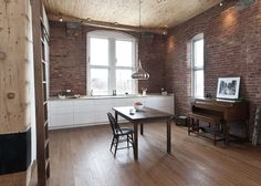 Oak floors in living room of 850 square-foot Montreal apartment renovation by Gepetto.