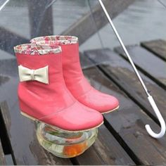 Pink ankle rain boots with hidden wedge and bow Super cute and adorable pink ankle length rain boots with floral trim and side bows! Shoes Winter & Rain Boots