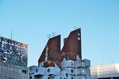The two peaks of the towers house the systems and water tanks- Kisho Kurokawa's Nakagin Capsule Tower in Tokyo