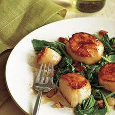 Pan-Seared Scallops with Bacon & Spinach | Community Post: 25 Delicious Scallop Recipes You Need To Make This Spring