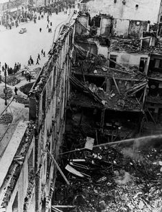Madrid, Spain. A building destroyed by Italo-German air raids. The Nationalist offensive on Madrid, which lasted from November 1936 to February 1937, was one of the fiercest of the Civil War. During this period Italy and Germany started helping the Nationalist forces, and the USSR the Popular Front government. By Robert Capa, (Winter 1936-1937)