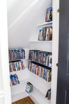 DIY DVD Storage Closet - Bless'er House How we packed tons of media and DVD storage into a small under-stairs closet using just a few pieces of lumber in one weekend. #closet #organization