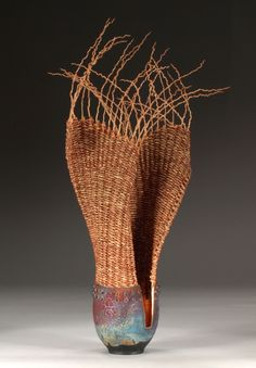 Marc Jenesel and Karen Pierce (Willow Bend Studios) | 'Dancing Couple' (Date Unknown). Raku, copper leaf, smoked rattan, dyed seagrass, palm inflorescence, semi-precious stone beads, copper wire, waxed linen.