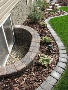 I've attached a picture of what we would like to do next to our house in the backyard. First question is, are those pavers that are on the border? Any idea of what we have to do to get this look? Other than kill the grass of course. Should we put sand down before the mulch? We might even put a doubl...