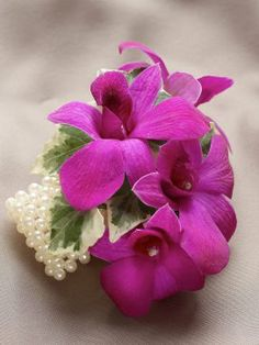 Add that beautiful finishing touch to your wedding or prom outfit with Interflora's luxury range of hand-made, floral wrist corsages and stylish buttonholes. Dendrobium Orchids, Purple Orchids, Magenta Wedding, Floral Wedding, Wedding Colors, Prom Flowers, Bridal Flowers, Wrist Corsage Wedding, Prom Corsage