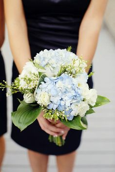 Bridesmaid's Beautiful Bouquet Comprised Of: Blue Hydrangea, White Spray Roses, White Waxflower, Green Hosta