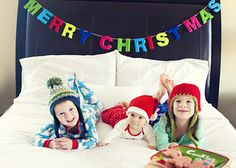 children at christmas picture, bed, cookies, hats, winter