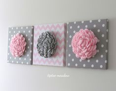 Make your walls pop with these gorgeous 3D Floral Wall hangings! Perfect for a baby nursery or girls bedroom. Decor that will impress wherever you choose to use it.  Product Details: ~ Crochet flower is approx. 8 in diameter ~ Crochet flower is securely hand sewn to fabric wrapped canvas ~ Fabric is 100% Cotton (chevron) and Cotton Twill (dots) ~ Size of canvas is 12 x 12  Our unique floral wall hanging designs are available in a beautiful array of colours and fabrics.  Customized options…