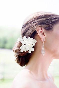 We love this romantic chignon. Possible bridesmaid hair