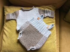 Hand knitted baby's jumper in powder blue and grey, side shoulder fastenings with wooden buttons for easy dressing With matching dungarees in powder blue and grey, with wooden fastening | Shop this product here: http://spreesy.com/AnitasKnitsOnline/79 | Shop all of our products at http://spreesy.com/AnitasKnitsOnline    | Pinterest selling powered by Spreesy.com