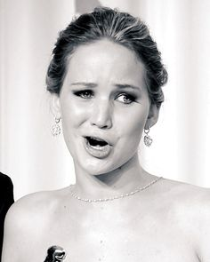 The Many Funny Faces of Jennifer Lawrence: a lot of my wedding photos looked like this while talking with guests