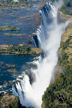 """The Victoria falls the mighty Victoria falls are truly a magnificent sight from the air. Known to the locals as """" Mosi Mosi uya Tuna"""" translated as the smoke that thunders. Victoria Falls bordering Zimbabwe and Zambia in Africa. Places Around The World, Oh The Places You'll Go, Places To Travel, Places To Visit, Around The Worlds, Wonderful Places, Beautiful Places, Amazing Places, Les Cascades"""