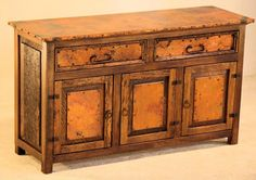 Reclaimed Mexican copper is handcrafted into beautiful rustic furniture with a hint of Spanish design for ranch, lodge, cabin & western decors. Copper Furniture, Rustic Furniture, Spanish Design, Spanish Style, Rustic Buffet, Rustic Cabinets, Aging Wood, Western Decor, Old Wood