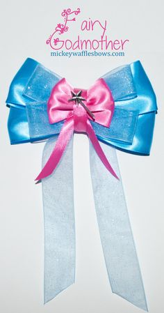 A medium sized (approx. 4 inches) hair bow inspired by the Fairy Godmother from Disneys Cinderella.    Choose your clip type using the drop down