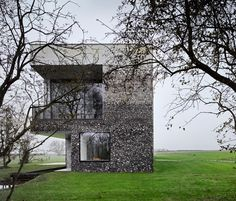 monolithic flint house by skene catling de la peña responds to its rural setting