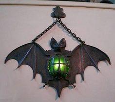 Bat Lamp, circa 1930, France.  Nailed to a barn door to ward off bad luck.