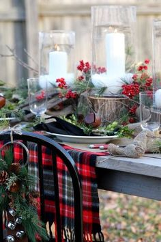 Rustic Christmas table setting. Love the cut tree rounds for centerpiece staging.