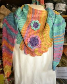 http://www.spinningmartha.de/WebRoot/Store11/Shops/61920259/MediaGallery/Pimpelliese.nl.pdf    Pimpelliese shawl