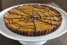 Pumpkin Chocolate Spiderweb Tart is the perfect fall dessert with a buttery crust, solid richness of chocolate, and an oh-so-creamy pumpkin filling.