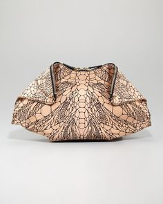 """Alexander McQueen. De-Manta Spine-Print Clutch Bag takes a cue from nature and magnifies a dragonfly spine to create an abstract mosaic effect on this origami-influenced clutch. The Alexander McQueen De-Manta clutch is named after the manta ray, with which it shares a hexagonal shape. Dragonfly spine print sateen with golden hardware. Logo plaque at top center. Two-way zip top; snap-over front corners. Hexagonal shape with arced bottom. 8""""H x 15""""W x 2""""D; bag weighs approx. 11oz. Made in…"""