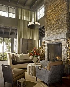 stacked stone fireplace + neutral palette + rustic design by Hickman Design Associates
