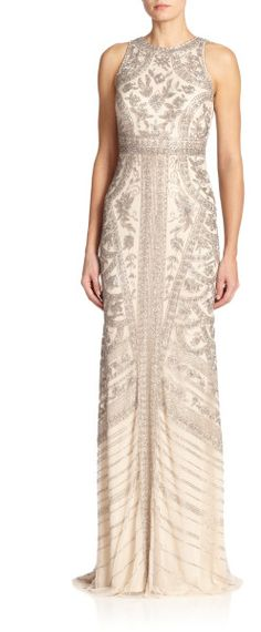 """Theia Silver Beaded Halter Gown Allover intricate beading instantly elevates this floor-sweeping column gown for a glamorous evening-ready look. Halter neckline. Sleeveless. Concealed back zip closure. Lined. About 45"""" from natural waist. Nylon. Spot clean. Color: SILVER BLONDE"""